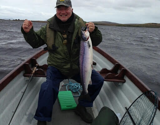 Mike-Brown-from-England-on-his-first-visit-with-an-8-lb-salmon